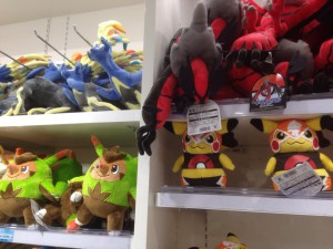 masked pikachu dolls and Chespin and other pokemon dolls.