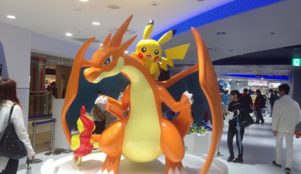inside picture of pokemon center mega tokyo 1.Charizard and pikachu.